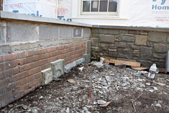 Can stone veneer be installed over brick for How to install stone veneer over stucco