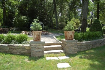retaining wall materials concrete vs natural stone